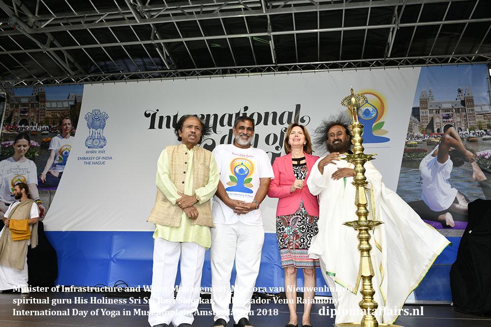 4.jpg Minister of Infrastructure and Water Management, Ms. Cora van Nieuwenhuizen, spiritual guru His Holiness Sri Sri Ravi Shankar and Ambassador Venu Rajamony Diplomat Affairs magazine